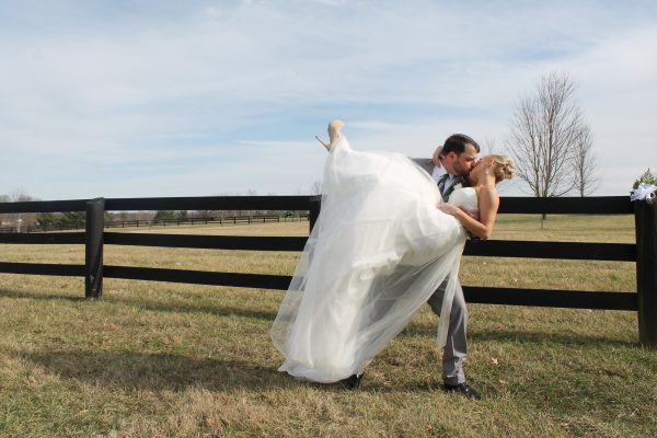 kentucky weddings and receptions on farm - bride and groom embrace