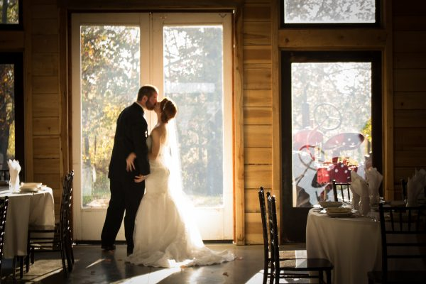 kentucky weddings and receptions on farm - bride and groom kissing