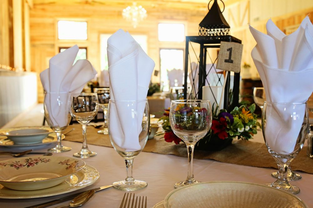 kentucky weddings and receptions on farm - wedding tables in barn