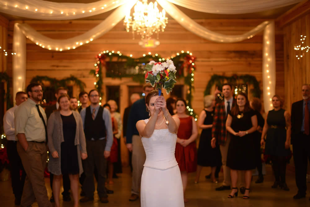 kentucky weddings and receptions on farm - bride throwing flowers
