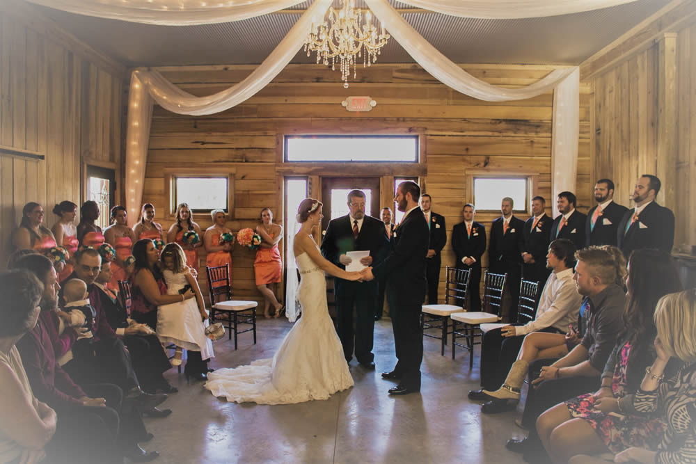 kentucky weddings and receptions on farm - bride and groom taking vows