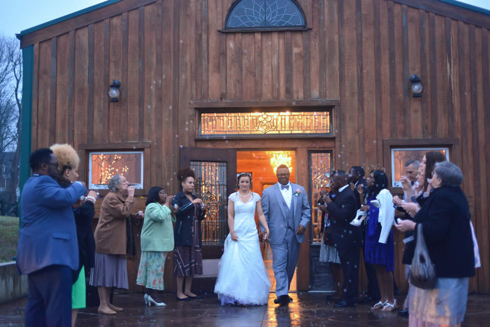 kentucky weddings and receptions on farm - bride and groom leaving the barn