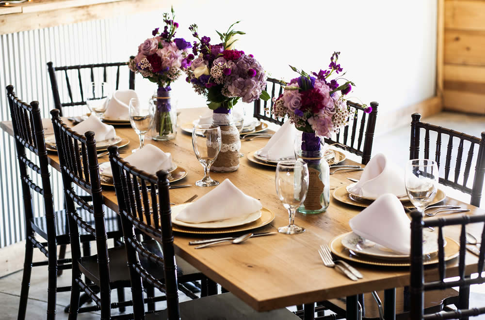 kentucky weddings and receptions on farm - table settings with 3 flower vases