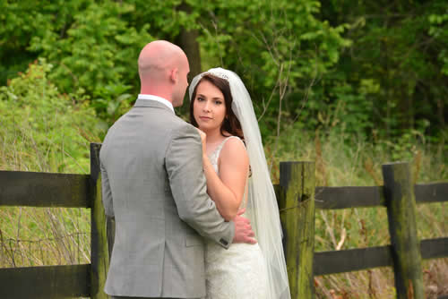 southern grace bed and breakfast weddings - couple in outdoor setting