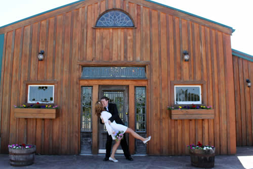 southern grace bed and breakfast weddings - couple in front of barn