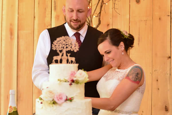 kentucky weddings and receptions on farm - bride and groom with cake