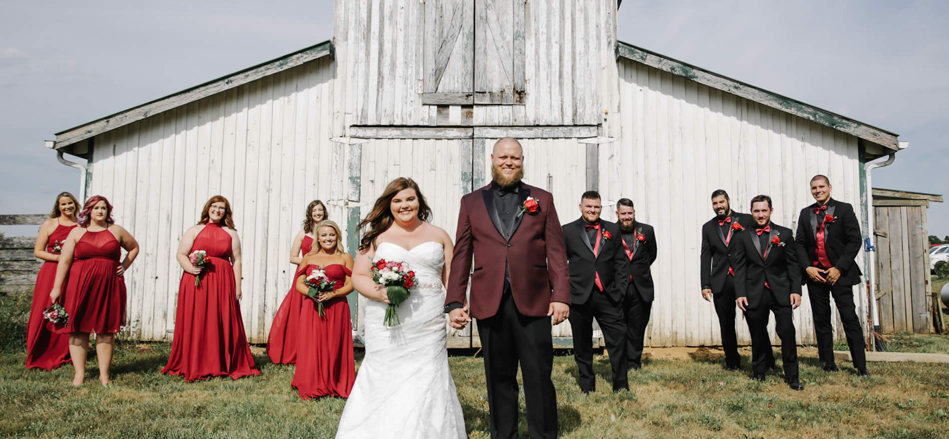 barn wedding near louisville ky - wedding party in front of barn