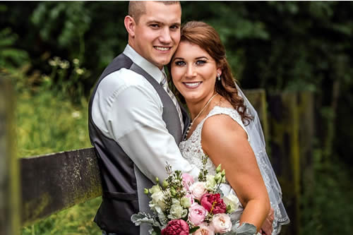 southern grace bed and breakfast weddings - couple walking in field